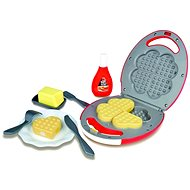 The waffle iron with accessories